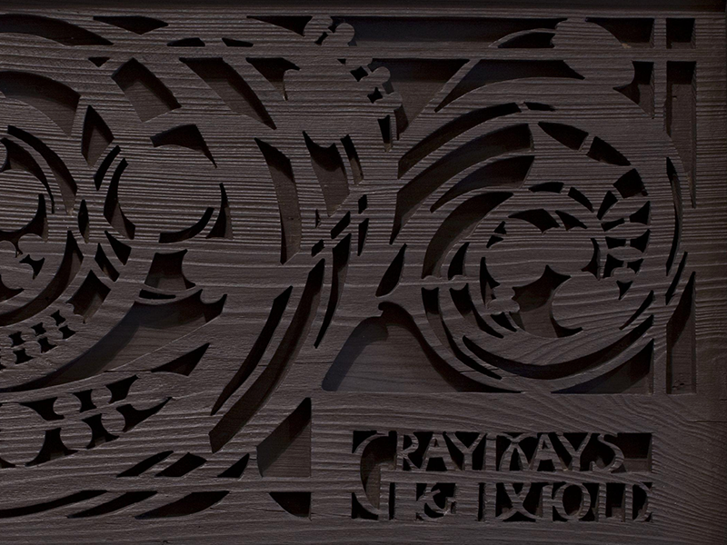 Art nouveau carved wood panel with the words Gray Days and Gold